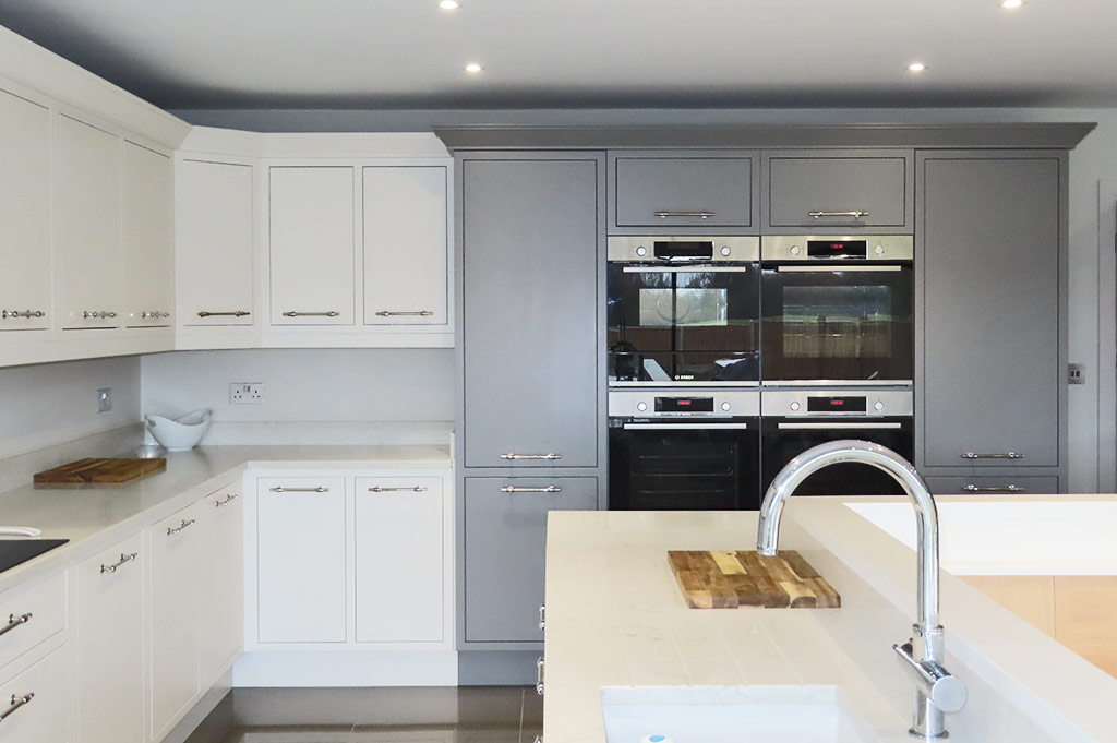 A DESIGNER IN-FRAME KITCHEN IN GREY AND WHITE